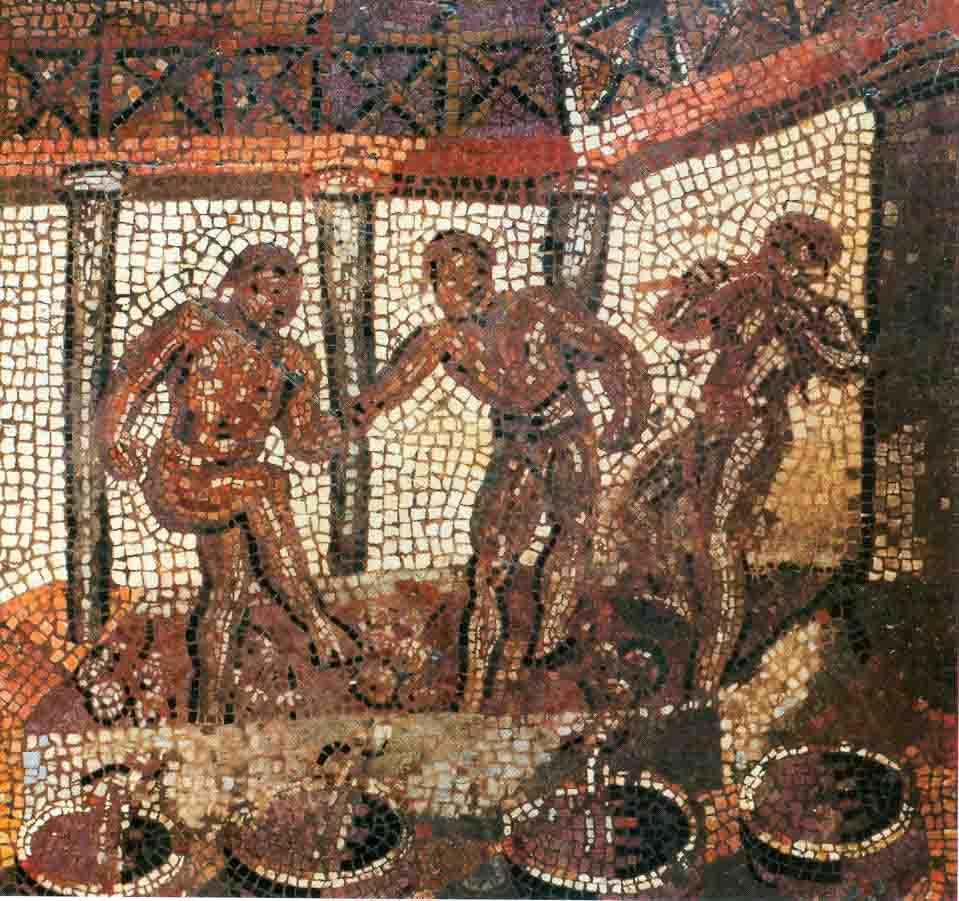 03. La pigiatura dell'uva. Il succo viene raccolto nei doli dove avverrà la fermentazione. Mosaico romano di età imperiale.